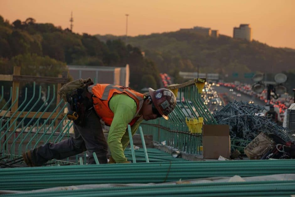 Construction worker alone on roof