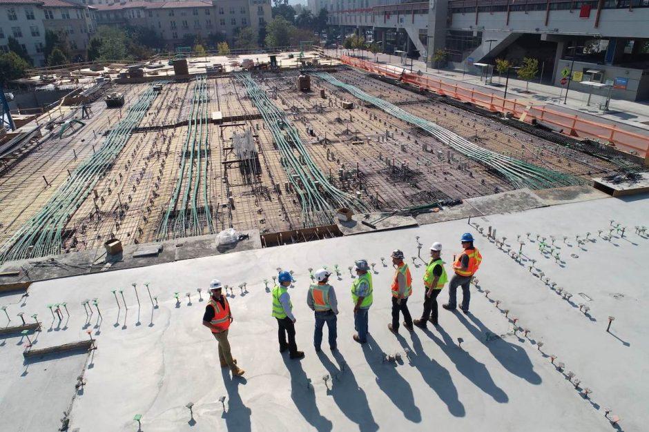 A construction team overlooks a job site